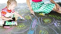 Gabriel playing with chalk