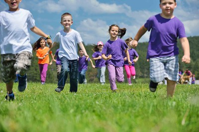 Kids in Grassy Field