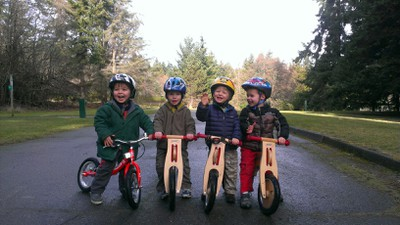 Toddlers on little bikes