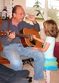 Bernie teaching guitar