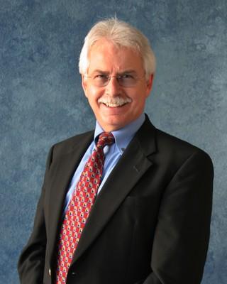 Dr. Gene Sharratt