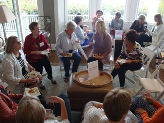 Grandparents gathered at Grandparent Happy Hour during National Grandparents Day