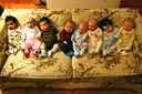 Newborns on a floral sofa